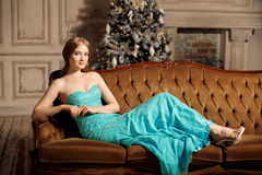 Luxury blonde in interior New Year. Young beautiful trendy girl Stock Images