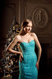 Luxury blonde in interior New Year. Young beautiful trendy girl Royalty Free Stock Image