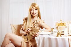 Luxury blonde in interior New Year. Young beauty trendy girl cel Stock Photos