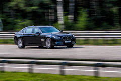 Free Luxury BMW 750 Speeding On Empty Highway Stock Photos - 54327863