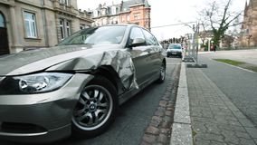 Luxury BMW German car parked city street damaged car accident insurance. Strasbourg, France - Mar 12, 2019: Panning to luxury BMW German car parked on city stock footage