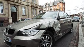 Luxury BMW German car parked city street damaged car accident insurance. Strasbourg, France - Mar 12, 2019: Tilt-down to luxury BMW German car parked on city stock video footage