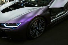 Luxury BMW i8 hybrid electric coupe. Plug-in hybrid sport car. Concept electric vehicle. Dark Matt colour. Car exterior details. Stock Image