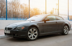 Luxury Bmw 6-series coupe parked in suburbia of Moscow City, new model of the brand BMW. Royalty Free Stock Photo