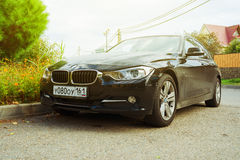 Luxury Bmw 5-series parked in suburbia of Sochi City, new model of the brand BMW. Royalty Free Stock Photography