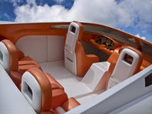Luxury Boat. Interior of a luxury sport boat in bright colors on a blue sky with white clouds Royalty Free Stock Photos