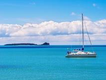 Luxury boat floats near the shore Stock Image