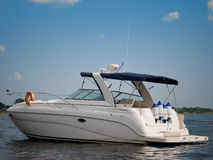 Luxury boat on summer river. Luxury boat on river against a blue sky Stock Images