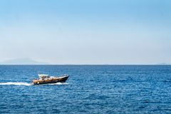 Luxury boat, yaht floating on the water, blue sea and sky with copyspace, transportation relax and trip concept stock photos