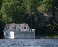 Luxury boathouse with living quarters Stock Photography