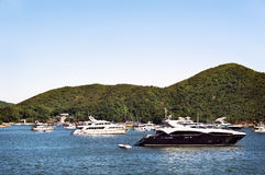 Luxury boats anchored in a bay off Hong Kong Island Royalty Free Stock Images