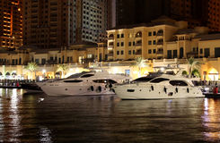 Luxury boats harboured in pearl Qatar. Beautiful boats at pearl Qatar harbour stock photo