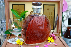 Luxury bottle of cognac. Decorated with flowers, costs 8000 eur Stock Photography