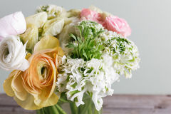 Luxury bouquet of different flowers in glass vase on wooden wall. Copy space Royalty Free Stock Photos