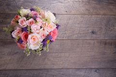 Luxury bouquet made of red roses in flower shop Valentines Bouquet of pastell roses. Luxury bouquet made of pink white red pastell roses on rustic wooden royalty free stock images