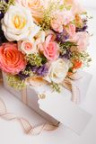 Luxury bouquet made of red roses in flower shop and white ribbon on wooden board. Overhead top view, flat lay. Copy. Luxury bouquet made of pink roses in flower stock photos