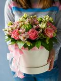 Luxury bouquets of different flowers in a hat box stock image