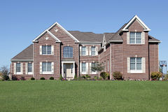Luxury brick home. In suburbs with large front lawn Royalty Free Stock Image