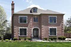 Luxury brick home with arched entry Stock Photo