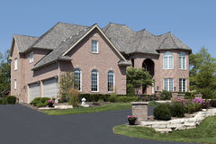 Luxury brick home with arched entry Royalty Free Stock Image