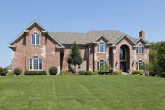 Luxury brick home with arched entry Stock Images