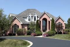 Luxury brick home with cedar roof Stock Photography