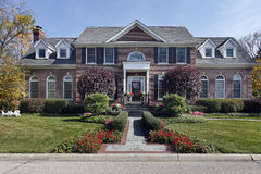 Luxury brick home with columns Stock Photos