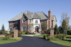 Luxury brick home with front balcony Stock Image