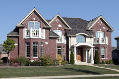 Luxury brick home with front bedroom balconies Royalty Free Stock Images