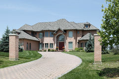 Luxury brick home with pillars Stock Photography