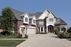 Luxury brick home with stone pillars Stock Photo