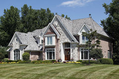 Luxury brick home in suburbs Royalty Free Stock Photography