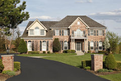 Luxury brick home in suburbs. With pillars Royalty Free Stock Photography