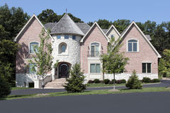 Luxury brick home with turret Royalty Free Stock Images