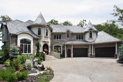 Luxury brick home with two turrets Stock Photography