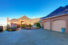Luxury brick house. Large luxury brick house with tile roof and excellent curb appeal. Big garage attached with stoned drive way Royalty Free Stock Photography