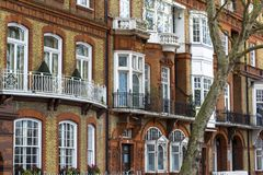 Luxury brick house with white windows in quiet area in central London. Apartments on the banks of the Thames royalty free stock photography