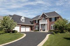 Luxury brick suburban home Stock Photos