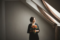 Luxury bride in black robe posing while preparing for the wedding ceremony Royalty Free Stock Images