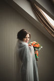 Luxury bride in black robe posing while preparing for the wedding ceremony Royalty Free Stock Photography