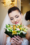 Luxury bride with a bouquet of flowers Royalty Free Stock Photos