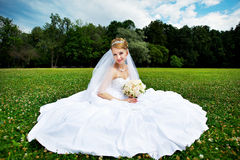 Luxury bride on the grass Stock Photo