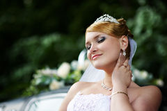 Luxury bride with a haughty look in wedding dress stock image