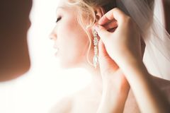 Luxury bride in white dress posing while preparing for the wedding ceremony Stock Photography