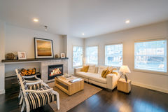Luxury bright living room with a fireplace. Interior design Stock Image