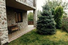 Luxury british stone cottage house in countryside, cozy rehabili Royalty Free Stock Images