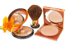 Luxury bronzers and Freesia. Luxury makeups bronzers with brush and Freesia flower. Isolated on white background royalty free stock photo