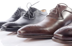Luxury brown and black shoes Royalty Free Stock Images
