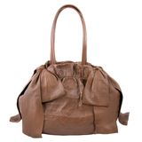 Luxury brown leather female bag isolated on white Stock Photography