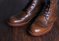Luxury brown shoes on wood background. Royalty Free Stock Image